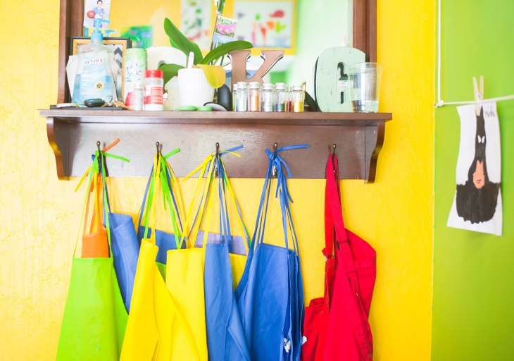 colorful aprons at pre-school and nursery school for kids art class