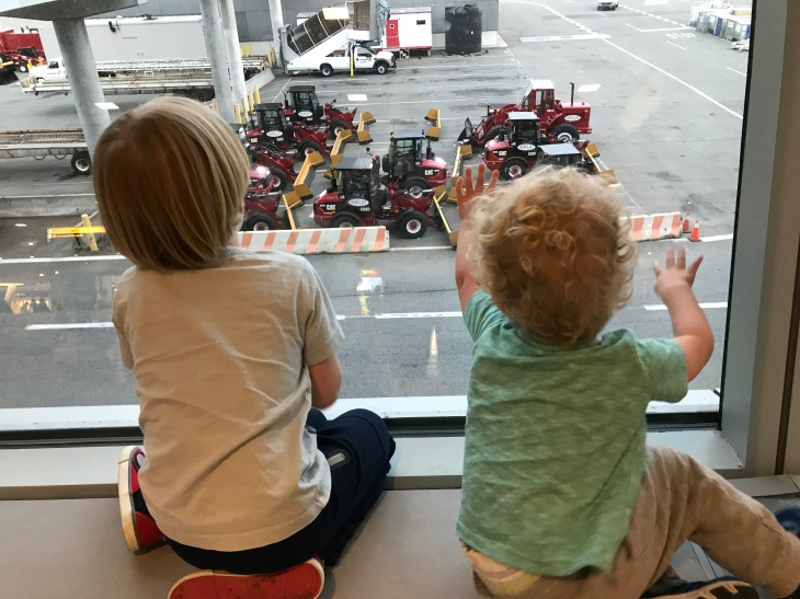 Aussie kids in NYC looking at trucks out the window