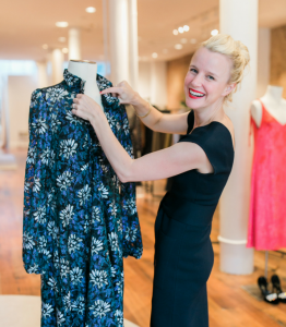 woman holding a dress