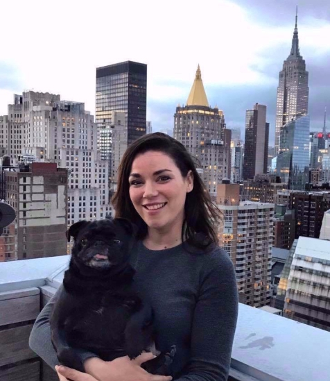 Australian woman with pet dog in Manhattan NYC near Empire State Building