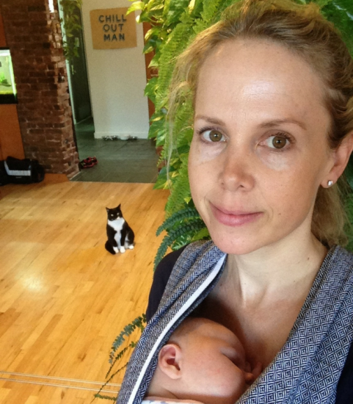 Emma McGregor-Mento at home NYC with baby and cat