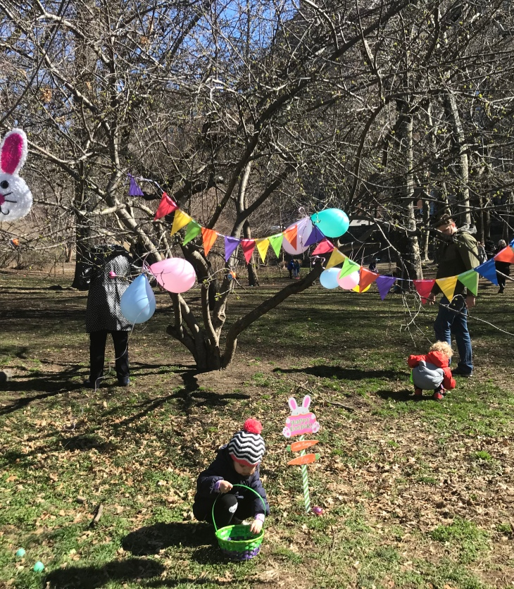 Children at Easter egg hunt in Manhattan, New York with Easter Bunny