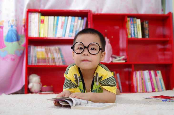 little boy reading book