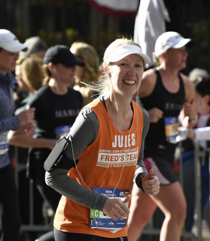 Australian woman running in New York City Marathon wearing an orange shirt