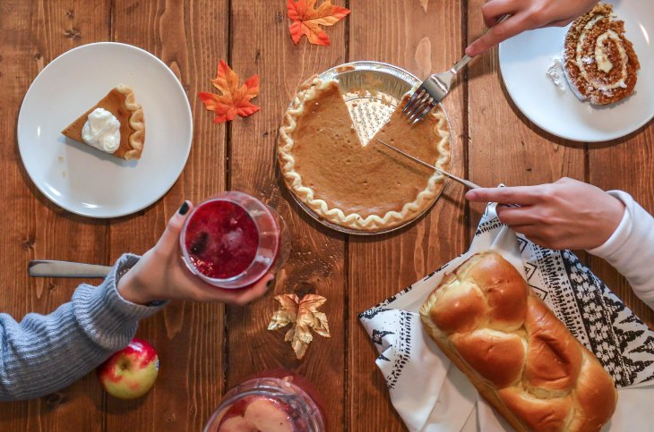 people serving pumpkin pie and cranberry sauce on Thanksgiving Day