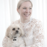 Cara Zelas author and educator holding her dog