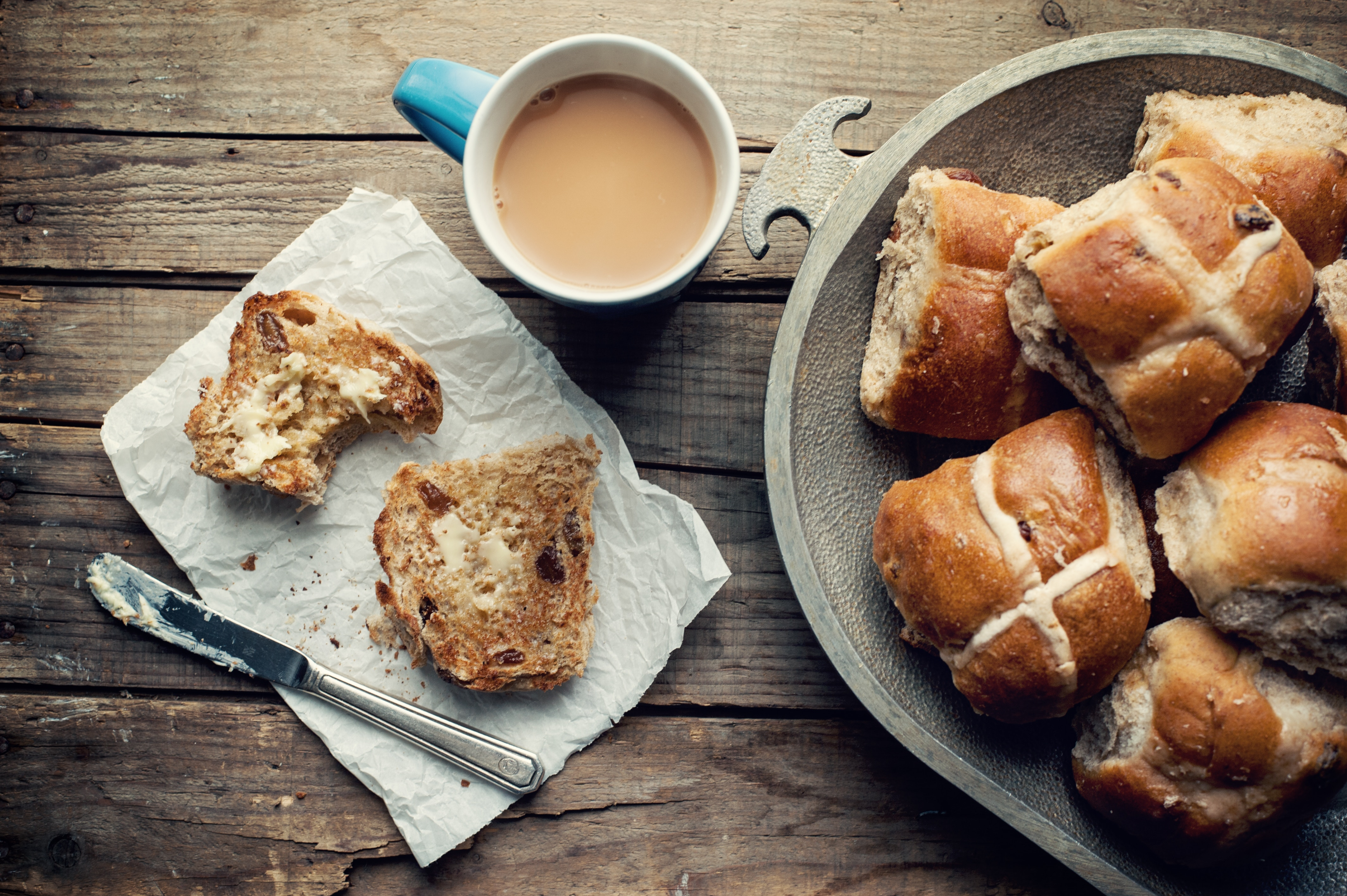 hot cross buns easter buns with butter cup of coffee