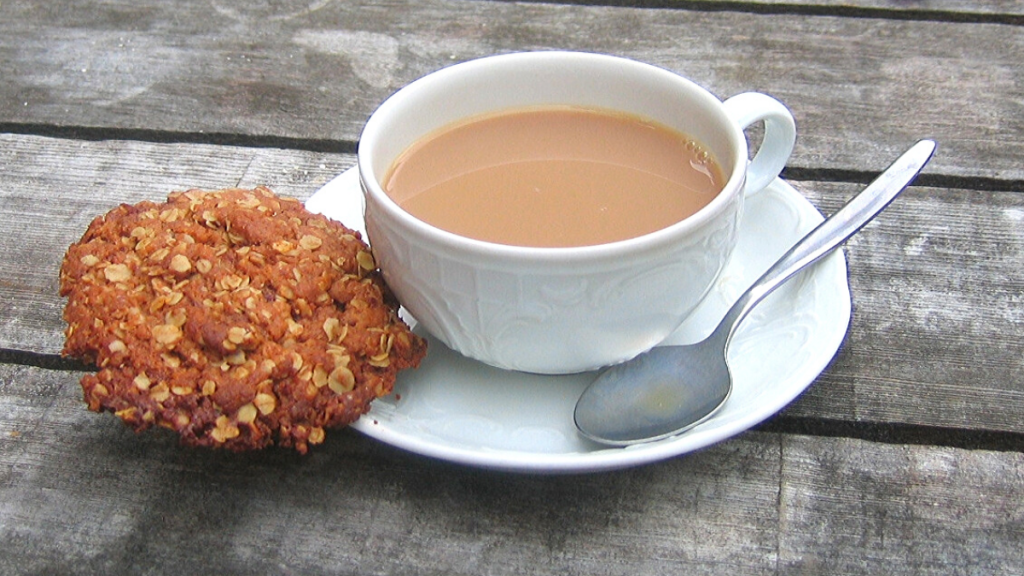 Anzac oatmeal biscuit cookie and cup of coffee on a table